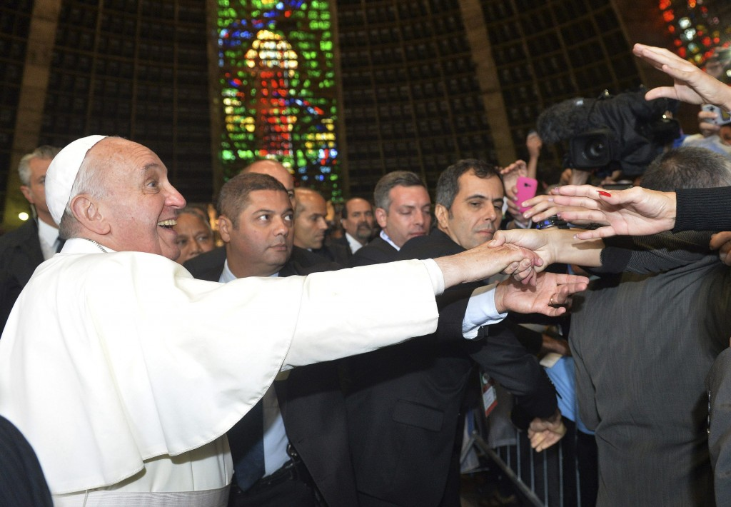 Pope Francis greets pilgrims from Argentina inside Rio cathedral