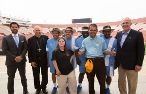 Los Angeles Archbishop Jose H. Gomez, second from left, and Supreme Knight Carl Anderson of the Knights of Columbus, far right, pose July 14 at the Los Angeles Memorial Coliseum with leaders and athletes of the 2015 Special Olympics World Games, scheduled next summer in Los Angeles. The Knights of Columbus has pledged $1.4 million to help cover costs for the games. (CNS photo/Victor Aleman, Vida-Nueva.com) (July 16, 2014) See SPECIAL OLYMPICS (CORRECTED) July 16, 2016.
