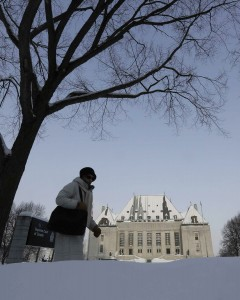 Woman walks past Supreme Court of Canada in Ottawa