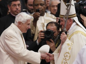 Retired Pope Benedict XVI greets Pope Francis at conclusion of consistory at which Pope Francis created 19 new cardinals at Vatican