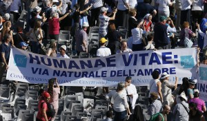 "Banner referencing ""Humanae Vitae,"" 1968 encyclical of Blessed Paul VI, seen at conclusion of beatification Mass in St. Peter's Square at Vatican"