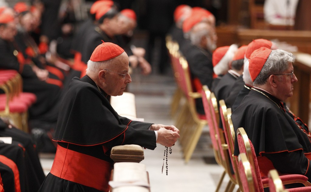 Cardinal George prays rosary before prayer service with eucharistic adoration in St. Peter's Basilica